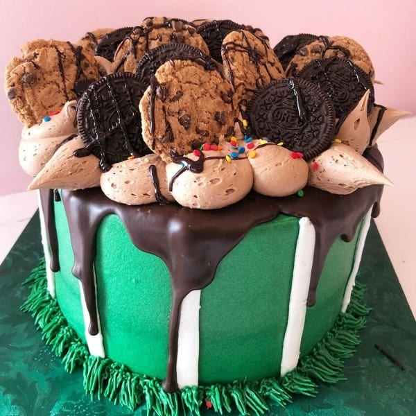 Cake topped with Oreos, Chocolate Chips, & Peanut Butter frosting